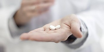 Abortion Pill in doctor's hand