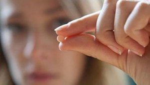 Abortion Pill in woman's hand